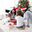 Family decorating a Christmas tree — Stock Photo