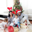 Family decorating a Christmas tree — Stock Photo #10294020