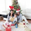 Stock Photo: Family decorating Christmas tree