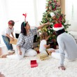 Family decorating a Christmas tree — Stock Photo #10294025