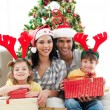Family decorating a Christmas tree — Stock Photo #10294035