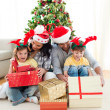 Family decorating a Christmas tree — Stock Photo #10294036