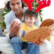 Father and son playing with a ball at Christmas — Stock Photo