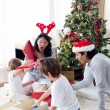 Happy family opening Christmas presents — Stock Photo #10294052