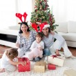 Family decorating a Christmas tree — Stock Photo #10294053
