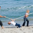 Animated family playing tug of war — Stock Photo