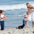 Lively family playing tug of war — Stock Photo