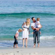 Animated family walking on the sand — Stock Photo #10294076