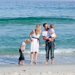 Animated family walking on the sand — Stock Photo