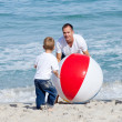 Royalty-Free Stock Photo: Jolly father and his son playing with a ball