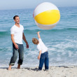 Royalty-Free Stock Photo: Happy father and his son playing with a ball