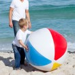 Smiling father and his son playing with a ball — Stock Photo #10294096
