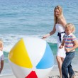 Cheerful mother and her children playing with a ball — Stockfoto #10294103