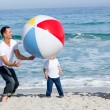Lively family playing with a ball - Stockfoto