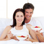Enamoured couple having breakfast — Stock Photo