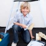 Smiling boy preparing paint — Stock Photo