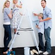 Happy Family decorating their new home — Stock Photo