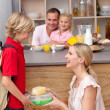 Caring mother packing school lunch to his son — Stock Photo #10294270