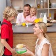 Caring mother packing school lunch to his son — Foto de stock #10294270