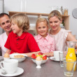 Jolly family having breakfast together — Stock Photo
