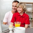 Cheerful father and his son having breakfast — Stock Photo