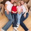 Tired family sleeping lying on the floor — Stock Photo