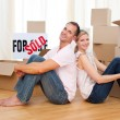 Stock Photo: Smiling couple relaxing while moving