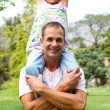 Joyful father giving his daughter piggy-back ride — Stockfoto #10294338
