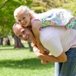 Happy little girl having fun with her father — Stock Photo