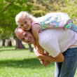 Cute little girl having fun with her father — Stock Photo
