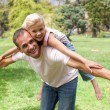Adorable little girl having fun with her father — Stock Photo #10294343