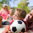 Happy family having fun at a picnic — Stock Photo #10294368