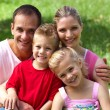 Close-up of a happy family smiling at the camera — Stockfoto
