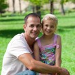 Smiling father and his daughter having a picnic — Stock Photo