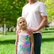 Cute little girl with her father in a park — Stock Photo