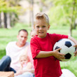 Little boy holding a soccer ball — Stockfoto