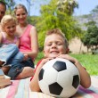 Smiling boy holding a soccer ball — Stock Photo