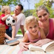 Happy young family enjoying a picnic — Stock Photo