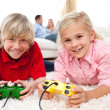 Children playing video games — Foto de stock #10294431