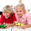 Adorable Children playing video games — Stock Photo