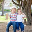 Stock Photo: Adorable siblings swinging