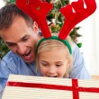 Father and his daughter opening Christmas gifts — Stock Photo