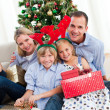 Portrait of a happy family at Christmas time — Stock Photo