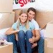 Intimate couple embracing after move in — Stock Photo #10294604