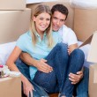 Stock Photo: Caucasicouple embracing after move in
