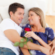 Stock Photo: Enamored lovers relaxing on sofa