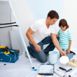 Father and his son painting in their new house — Stock Photo