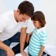 Cute little boy and his father painting a room - Stock Photo