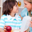 Stock Photo: Cute little boy and his mother preparing his snack