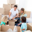 Positive family packing boxes — Stock Photo